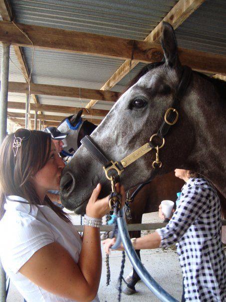 Lisa kissing a horse