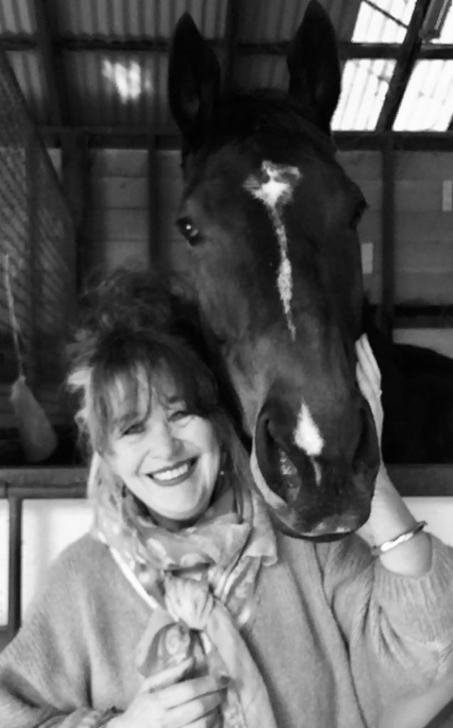 Practitioner Jo Gil with a horse