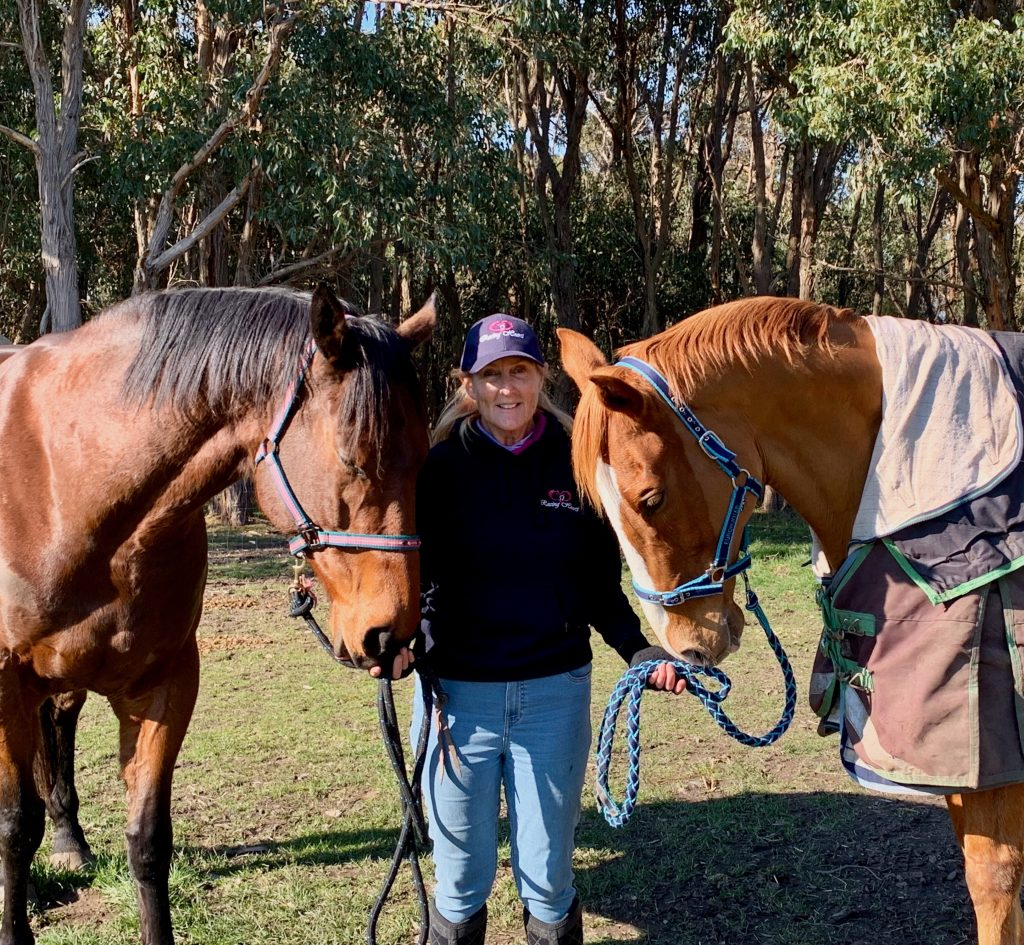 Sue Morgan posing with horses